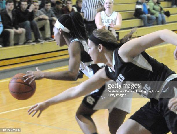 Conrad Weiser's TaCari Talford grabs the rebound and rus by Berks Catholic's Courtney Wensel . The Conrad Weiser Scouts defeat the Berks Catholic...