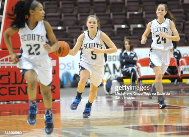 Conrad Weiser's TaCari Talford , Kennedy Lutz and Hannah Racis make their way up the court. 2/25/2015 - Photo by Harold Hoch - GIRLS BASKETBALL The...