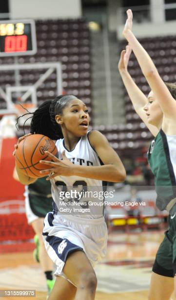 Conrad Weiser's TaCari Talford makes her move around West Perry's Madison Urich . 2/25/2015 - Photo by Harold Hoch - GIRLS BASKETBALL The Conrad...