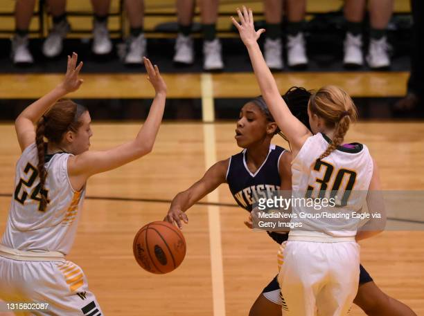 Conrad Weiser's TaCari Talford passes away from Archbishop Wood's Katie May and Claire Bassetti .GIRLS BASKETBALL Conrad Weiser Scouts lose 56-46 to...