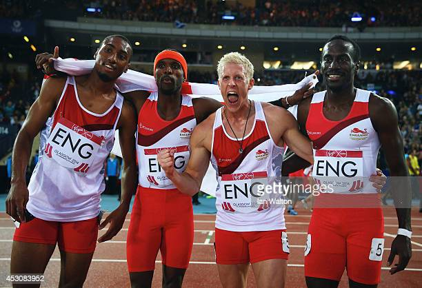 Conrad Williams Matthew HudsonSmith Michael Bingham and Daniel Awde of England celebrate winning gold in the Men's 4x400 metres relay at Hampden Park...