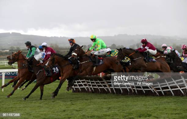 Conright Boy ridden by jockey Donagh Meyler amongst other runners and riders during the JLT Handicap Hurdle in the during day three of the...
