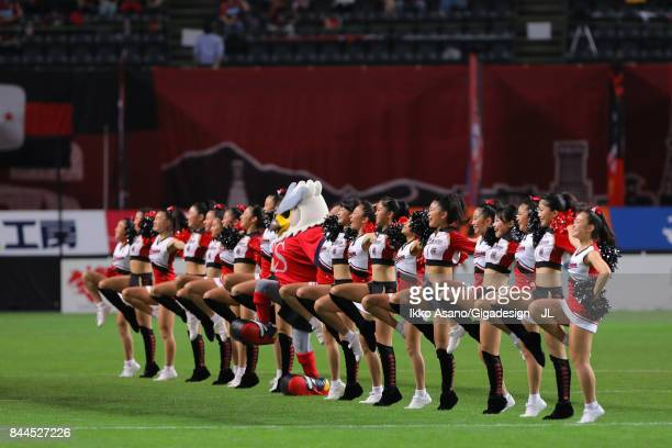 Consadole Sapporo cheer leaders perform with team mascot Dolekun prior to the JLeague J1 match between Consadole Sapporo and Jubilo Iwata at Sapporo...