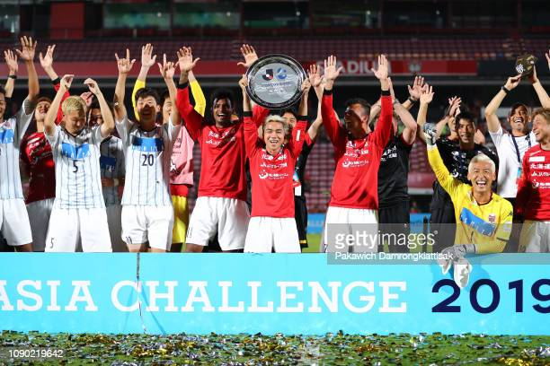 Consadole Sapporo players and staff celebrate the JLeague Asia Challenge 2019 Thailand trophy after the preseason friendly match between True Bangkok...