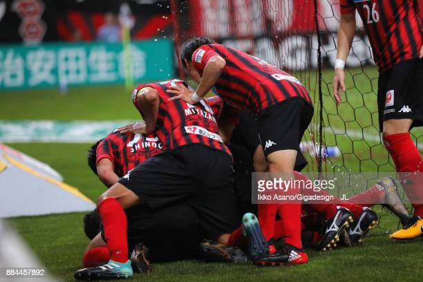 Consadole Sapporo players celebrate their team's third goal scored by Tomonobu Yokoyama during the JLeague J1 match between Consadole Sapporo and...