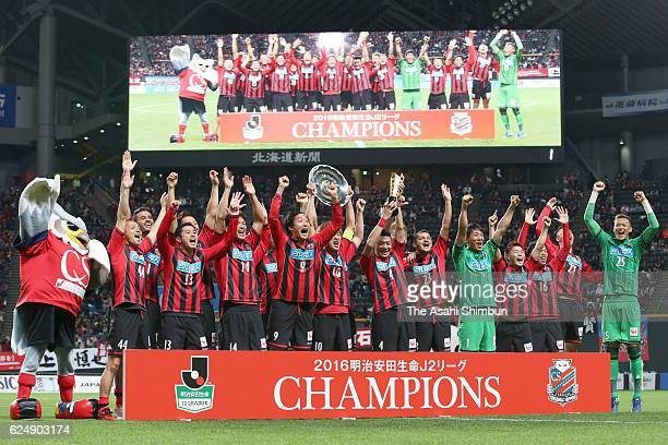 Consadole Sapporo players celebrate winning the JLeague second division title and promotion to the top division after the JLeague second division...