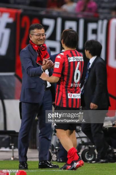 Consadole Sapporo President Yoshikazu Nonomura congratulates Shingo Hyodo after the JLeague J1 match between Consadole Sapporo and Sagan Tosu at...