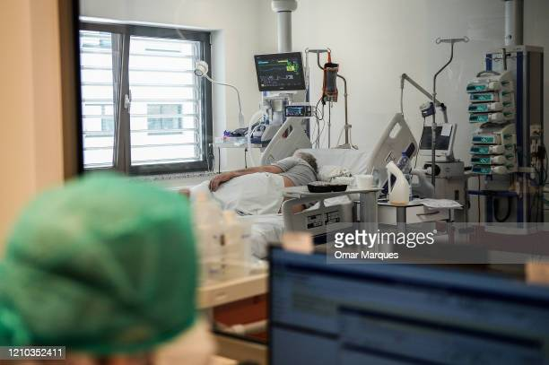 A conscicous COVID19 patient looks to a window inside the Intensive Care Unit for COVID 19 patients of Krakow's University Hospital on April 18 2020...