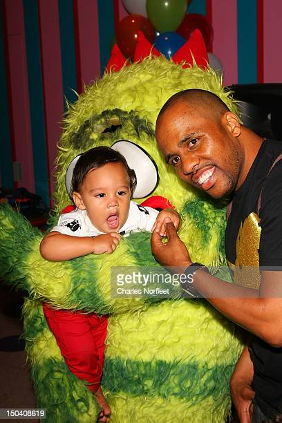 Consequence and his son Caiden attend Caiden's First Birthday Party at Dylan's Candy Bar on August 16 2012 in New York City