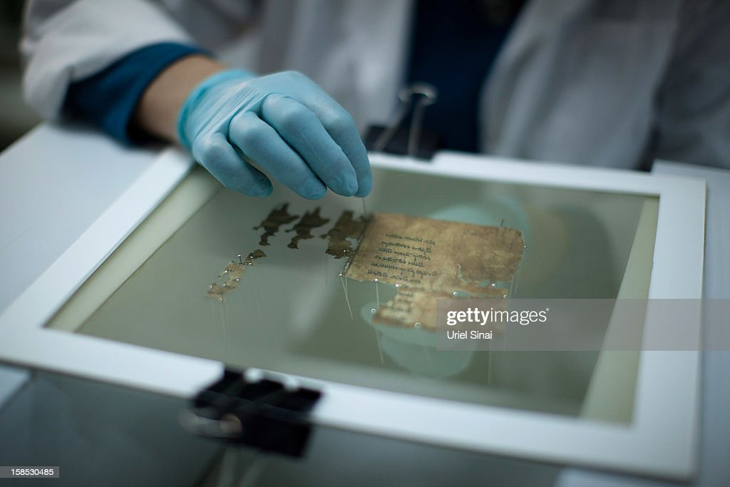 A conservation analyst from the Israeli Antiquities department prepares fragments of the 2000-year-old Dead Sea scrolls at a laboratory before photographing them on December 18, 2012 in Jerusalem, Israel. More than sixty years after their discovery Israel have put 5,000 fragments of the ancient Dead Sea scrolls online in a partnership with Google.