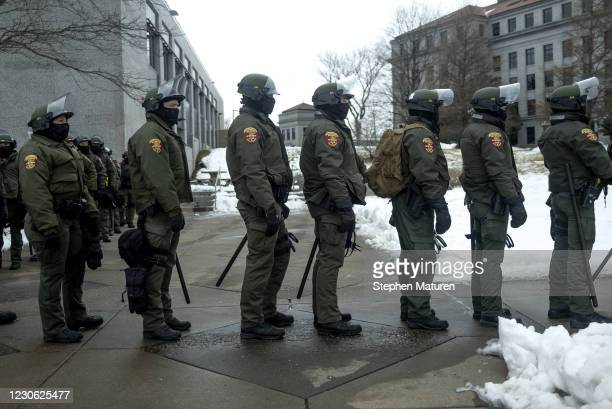Conservation Officers with the Minnesota Department of Natural Resources gear up before a protest scheduled outside the Capitol building on January...