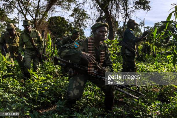ICCN conservation rangers and FARDC Congolese Army soldiers on long range patrol to locate and destroy FDLR a Hutu led militia movement who fled into...