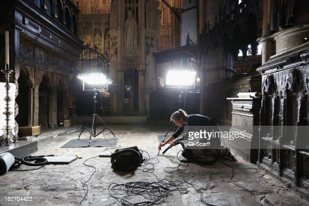 Conservation staff at Westminster Abbey clean the Cosmati pavement surrounding the tomb of Edward the Confessor and asses it for conservation on...