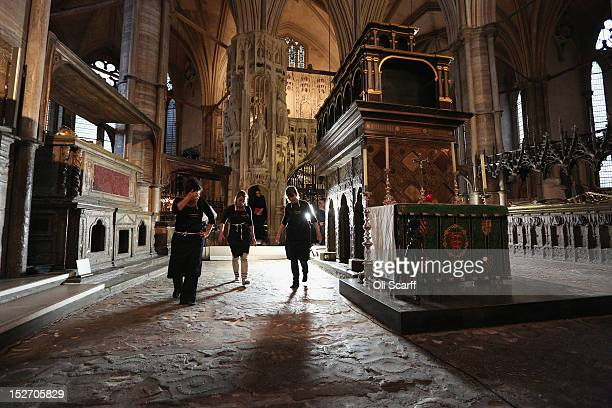 Conservation staff at Westminster Abbey examine the Cosmati pavement surrounding the tomb of Edward the Confessor to asses it for conservation after...