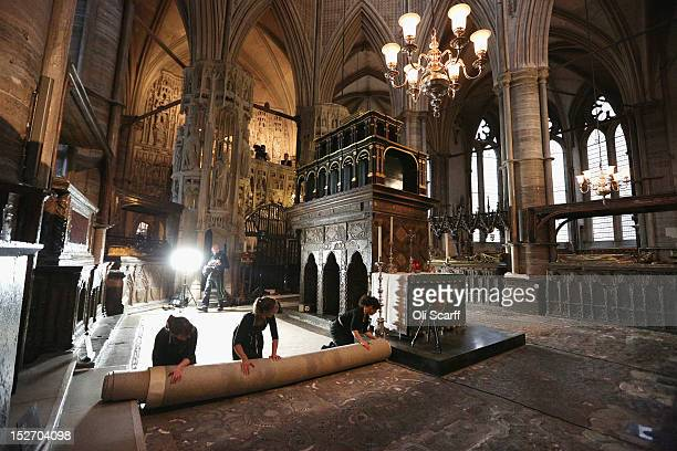 Conservation staff at Westminster Abbey remove the protective covering on the Cosmati pavement surrounding the tomb of Edward the Confessor to asses...