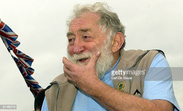 Conservationist David Bellamy watches as ExRoyal Navy frigate The Scylla is sunk amidst explosions March 27 2004 off Whitsands Bay Cornwall England...