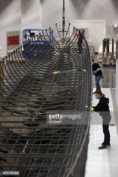 Conservationists at the British Museum clean and prepare the metal frame of a forthcoming exhibition of the surviving timbers of the longest Viking...