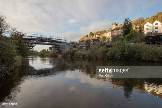Conservationists begin repair work on the world's first iron bridge erected over the River Severn in Shropshire in 1779 on November 6 2017 in Telford...