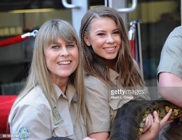 Conservationists/TV personalities Terri Irwin and Bindi Irwin with Angelina The Anaconda attend the Steve Irwin Posthumous Star Ceremony held on The...