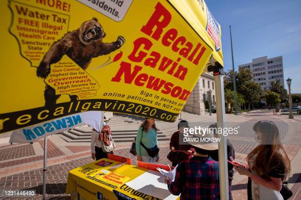 Conservative activists gather signatures in a recall effort against California Governor Gavin Newsom near Pasadena City Hall, in Pasadena, California...