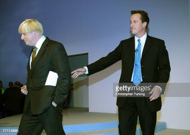 Conservative candidate for The Mayor of London Boris Johnson leaves the stage with the help of party leader David Cameron after addressing delegates...