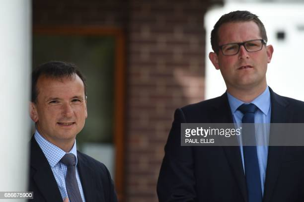 Conservative candidate for Wrexham Andrew Atkinson and Britain's Wales Secretary Alun Cairns wait to greet Britain's Prime Minister Theresa May at...