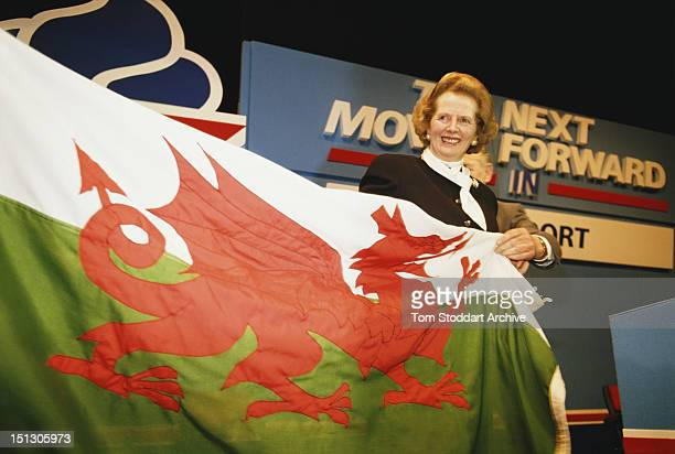 Conservative candidate Margaret Thatcher poses with the Flag of Wales featuring the Ddraig Goch or Red Dragon during the General Election campaign UK...