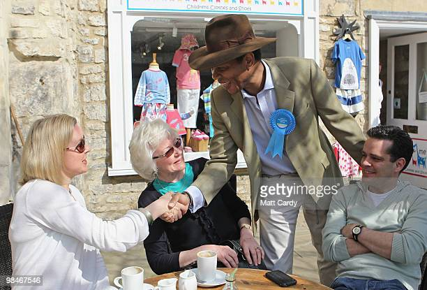 Conservative candidate Wilfred EmmanuelJones speaks to prospective voters as he campaigns in the new Wiltshire parliamentary seat on April 10 2010 in...