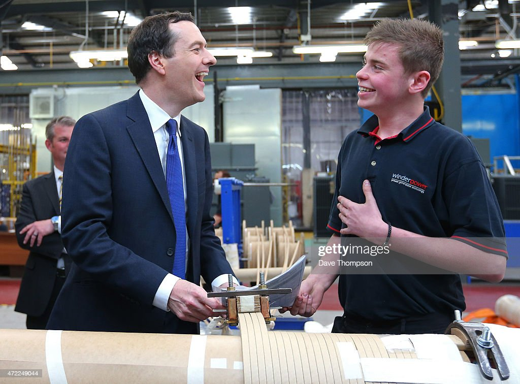 Conservative Chancellor George Osborne laughs as he meets apprentice Jordan Hankin during a visit to Winder Power on May 5, 2015 in Pudsey, England. The British public go to the polls in the general election on May 7th.