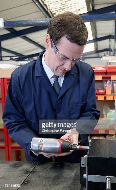 Conservative Chancellor George Osborne uses a an air tool to tighten a nut during a visit to EPS switchgear engineering company on April 28 2015 in...