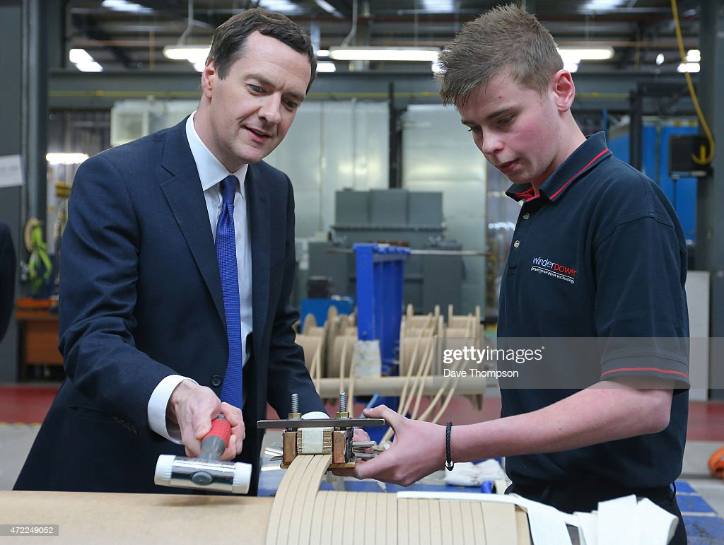 Conservative Chancellor George Osborne works alongside apprentice Jordan Hankin during a visit to Winder Power on May 5, 2015 in Pudsey, England. The British public go to the polls in the general election on May 7th.