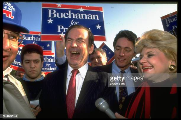 Conservative columnist/pundit Pat Buchanan sharing laugh w crowd during bus tour stop on campaign trail for Repub party presidential nomination