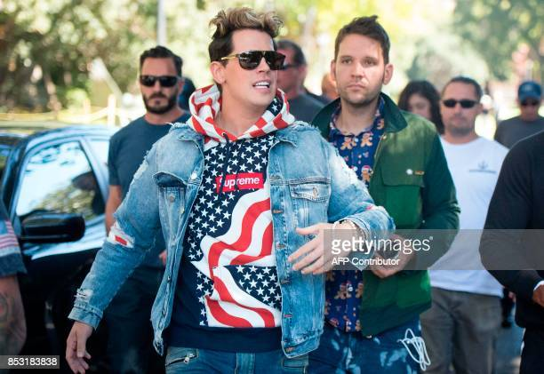 Conservative commentator Milo Yiannopoulos is escorted to the University of California Berkeley campus where he is expected to speak to dozens of...