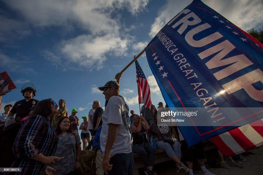 Conservative demonstrators rally at an 'America First' demonstration on August 20, 2017 in Laguna Beach, California. Organizers of the rally describe it as a vigil for victims of illegal immigrants and refugees. Opponents say the demonstration is steeped in racism.