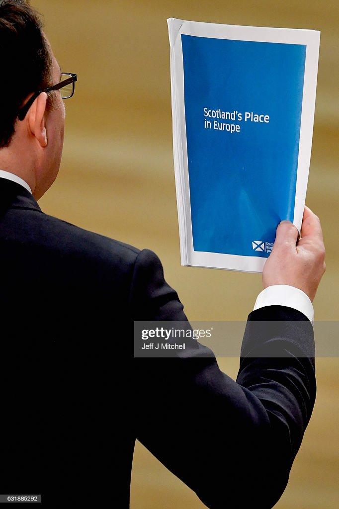 Conservative economy spokesman Dean Lockhart holds up a Brexit document during a debate to keep Scotland in the European single market at the Scottish Parliament on January 17, 2016 in Edinburgh, Scotland. The Prime Minister spoke to Nicola Sturgeon ahead of a speech confirming that the UK will leave the EU. The SNP leader has repeatedly raised the possibility of a second independence referendum if Scotlands membership of the single market is threatened by a so called hard Brexit.