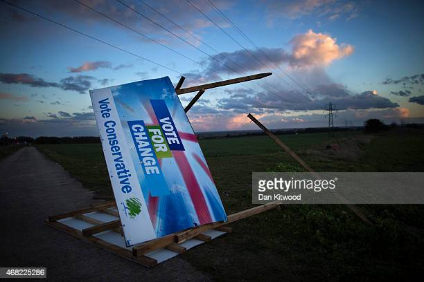 Conservative election billboard is blown over in high winds in a field on March 31, 2015 near Ramsgate, United Kingdom.