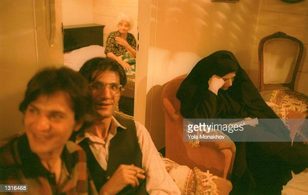 Conservative guest at a June 11, 2001 wedding party in northeastern Tehran keeps on her chador inside the house and stays in the corner, avoiding the...