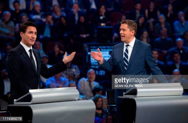 Conservative leader Andrew Scheer and Canadian Prime Minister and Liberal leader Justin Trudeau gesture to each other as they both respond during the...