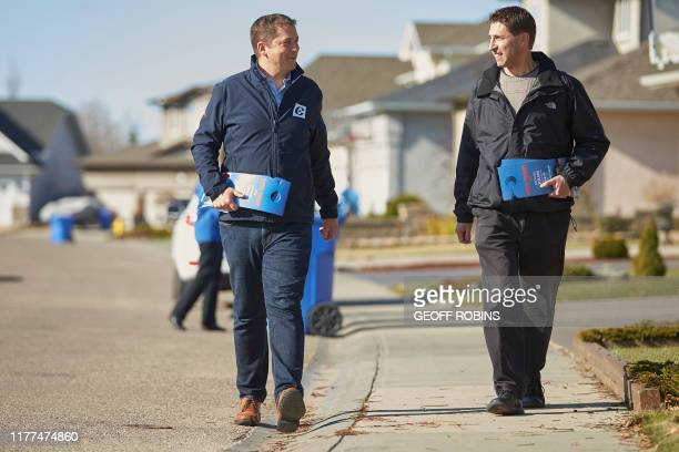 Conservative leader Andrew Scheer does some election day canvasing with local candidate Michael Kram in Regina Saskatchewan on October 21 2019...