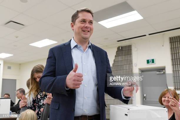 Conservative Leader Andrew Scheer gives a thumbs up as he votes in the federal election in Regina Saskatchewan on October 21 2019 Canadians began...