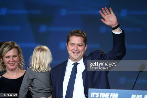 Conservative leader Andrew Scheer with his wife Jill and one of their children leave the stage after his defeat to the Liberal Party at an election...