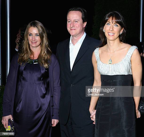 Conservative leader David Cameron and his wife Samantha arrive along with host Anya Hindmarsh at the Conservative Party Black and White Ball in...