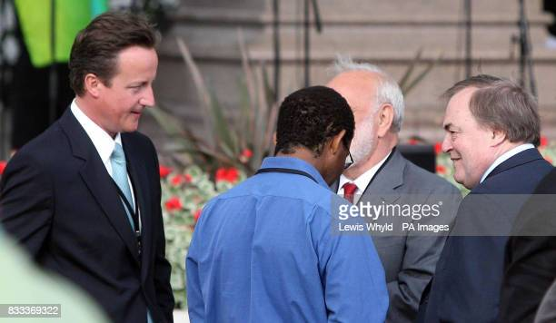 Conservative Leader David Cameron and Labour MP John Prescott at the unveiling of a statue of former South African President Nelson Mandela in...