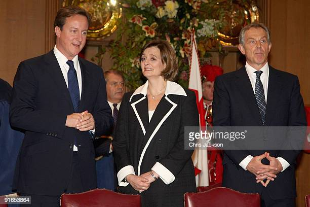 Conservative leader David Cameron chats to Cherie Blair as former Prime Minister Tony Blair looks on during a reception at London Guildhall after a...