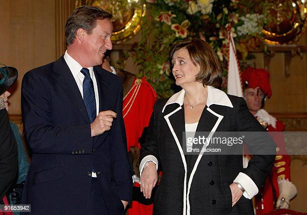 Conservative leader David Cameron chats to Cherie Blair during a reception at London Guildhall after a Service of Commemoration to mark the end of...