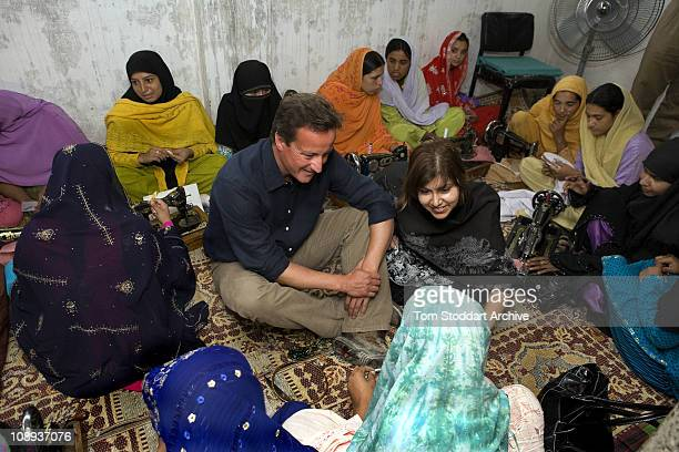 Conservative leader David Cameron now British Prime Minister and Baroness Sayeeda Warsi pictured at a women's work group project during a visit to...