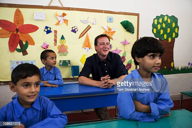 Conservative leader David Cameron now British Prime Minister pictured with school children in their classroom during a visit to Islamabad Pakistan...