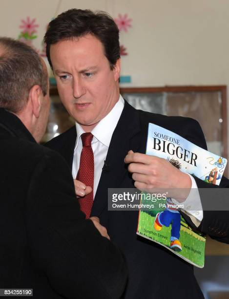 Conservative Leader David Cameron prepares to read a story to children at the Rainbow childcare centre in Whitley bay today ahead of the start of the...