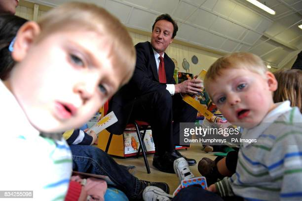 Conservative Leader David Cameron reads a story to children at the Rainbow childcare centre in Whitley bay today ahead of the start of the...