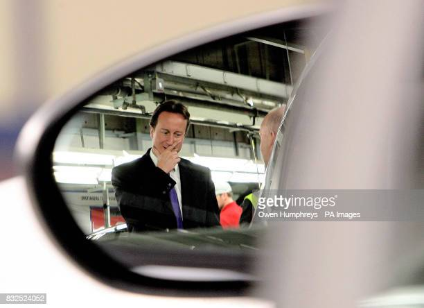 Conservative leader David Cameron reflected in a car wing mirror during a visit to the Nissan car plant in Sunderland